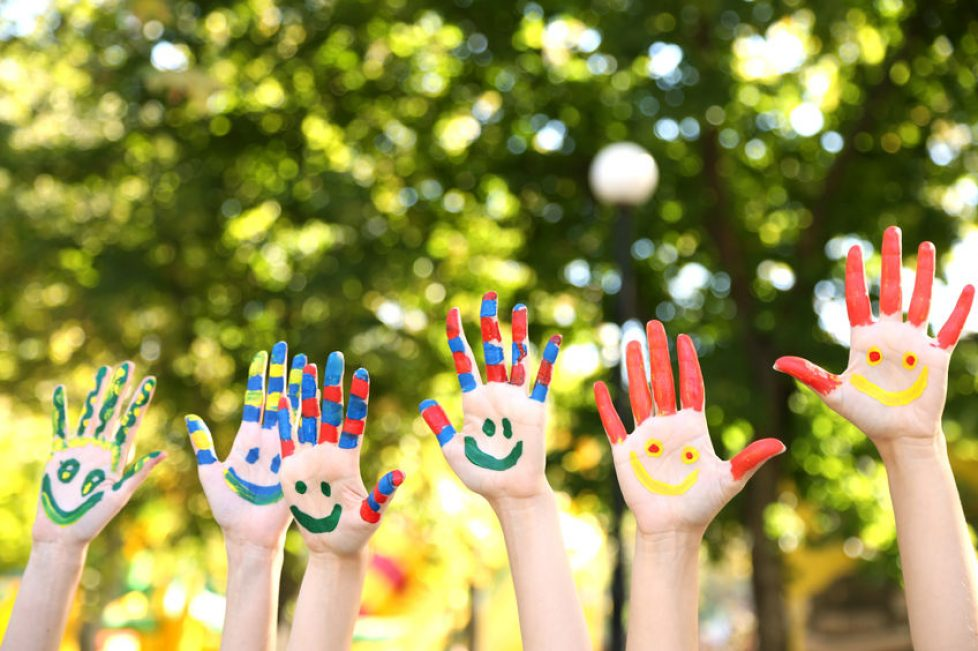 46903017 - smiling colorful hands on natural background